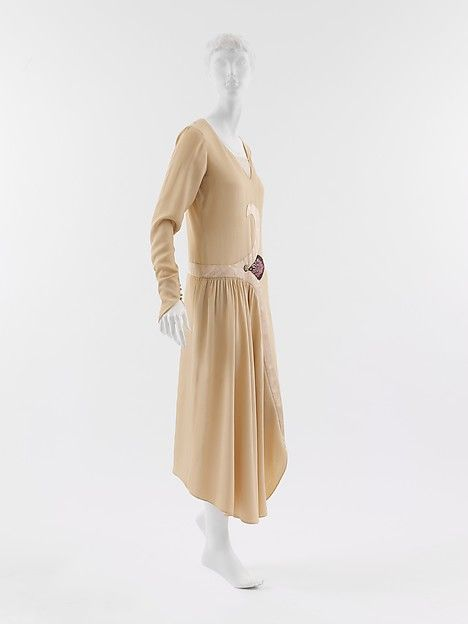 In Poiret's oeuvre, leitmotifs distinguish his designs that, otherwise, conform to prevailing fashions. This dress, from the year before his couture house closed, reflects the period of transition from the recto-verso planarity characteristic of the 1920s chemise dress to a period when the cubistic fracturing of a garment made a design's construction comprehensible only in rotation