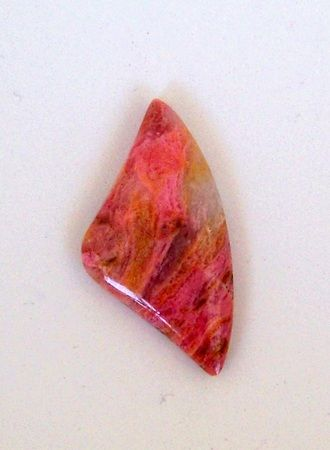 California Rhodonite Cabochon 2487  $16.95  This rhodonite originates from Wrightwood, California. This cabochon has swirls of pink, white and a pale orange.