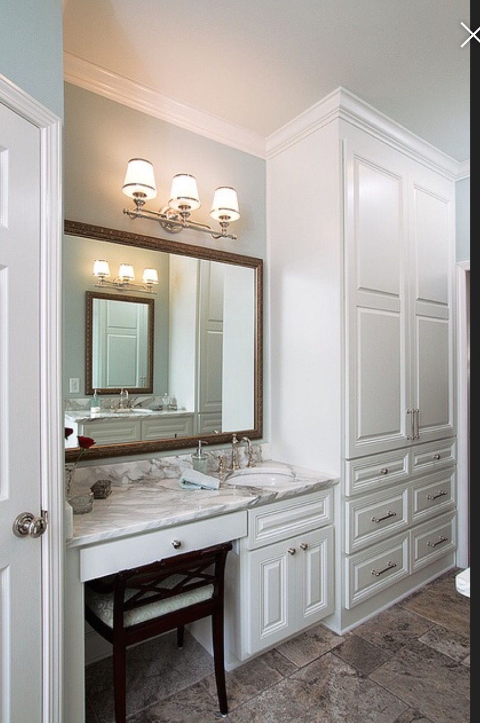 Walk in closet with a vanity & sink Small bathroom