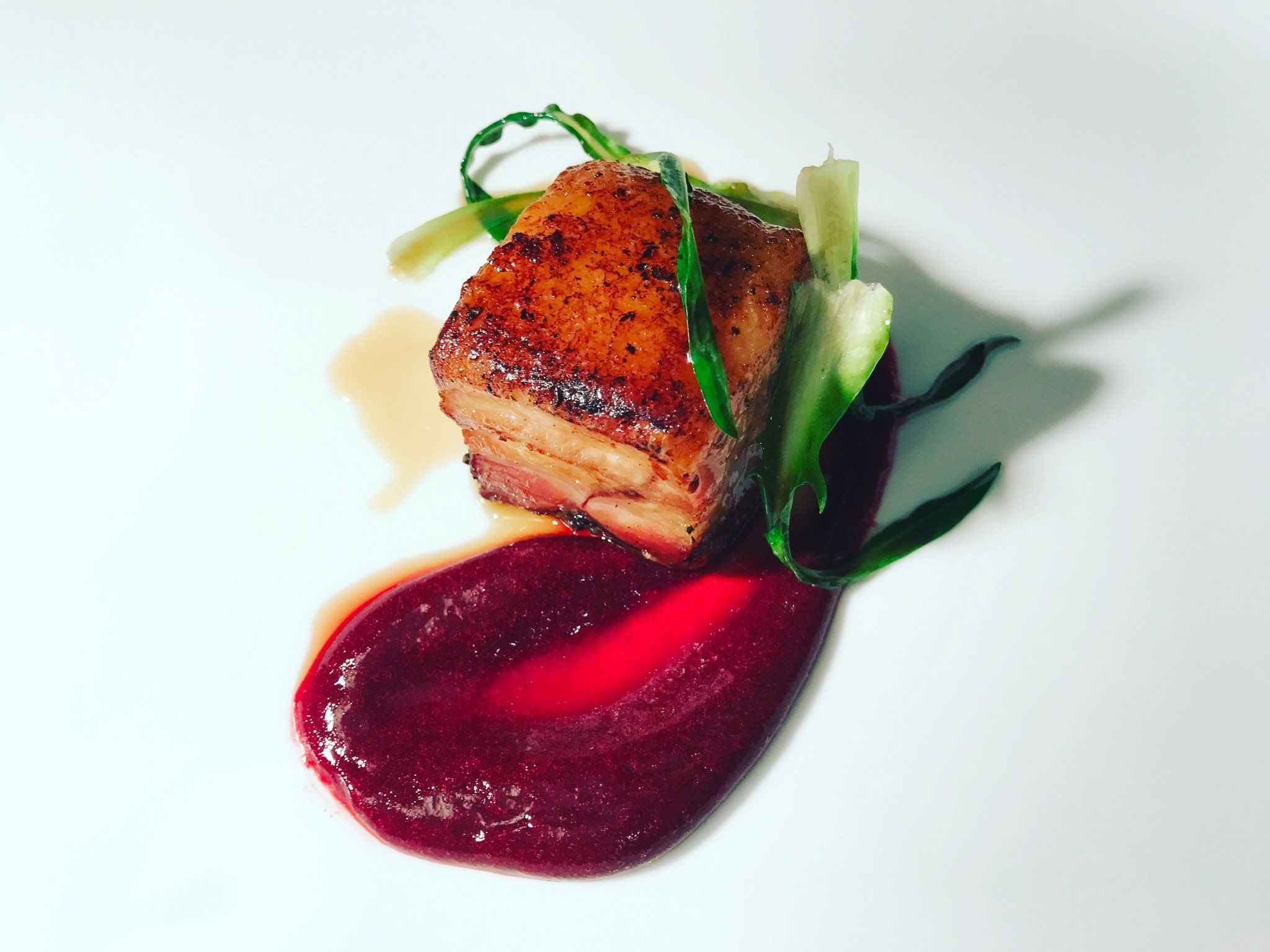 Photo of Pork belly cooked at low temperature, beet gel …