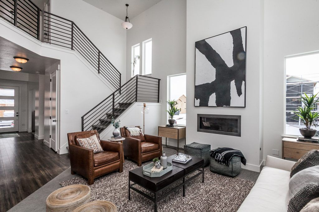 Great Room With A Black Metal Railing Decor Idea Gallery Edge Homes Home House Flooring Great Rooms