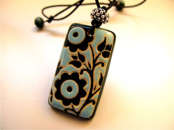 Clay pendant blue black clean lines flower motif pottery ceramics clay jewelry