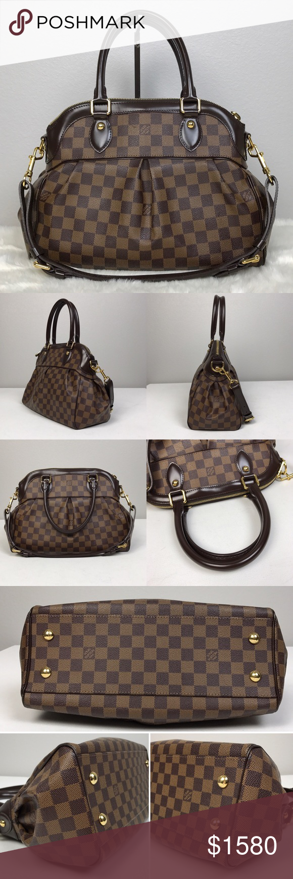 """Louis Vuitton Trevi PM Damier Ebene Satchel Louis Vuitton Trevi PM Damier Ebene Satchel. Dark brown leather trim, gold hardware, double rolled leather shoulder straps, detachable adjustable leather longer shoulder strap. Gold feet on the bottom, top zip closure, red alcantara fabric lining, 2 Interior slip pockets. Made in France. In great condition. Some scuff marks on the exterior. Minor wears at the corners. Clean lining. Dust bag included. Dimension (approximate): 13.4"""" x 5.9"""" x 9.4""""…"""