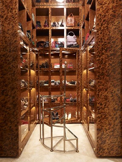 Tortoise Closets - In this walk in closet designed by Jonathan Adler, every single surface is adorned in a tortoise shell finish. Talk about drama! While this closet appears to be designed for a fashionable woman, we think that tortoise shell has a very gender neutral aesthetic.