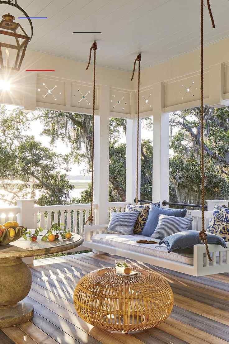 The 2019 Southern Living Idea House - Part 1 | The Hank Miller Team The 2019 Southern Living Idea House - Part 1 | The Hank Miller Team Swing Porch - The 2019 Southern Living Idea House - Beach house decor. Love the bedswing from the Original Charleston swing Company, Zuri decking - looks like hardwood, round table, blue and white accent pillows and copper gas lights - what a water view! Coastal living. #coastal #porch #porchideas #coastalliving #house #houseideas #homedecor #porchdecor #souther