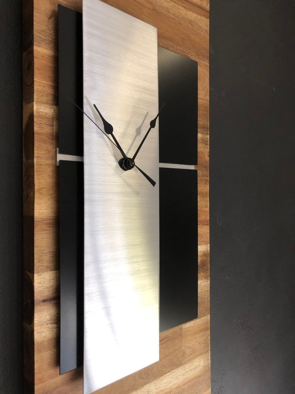 10856bde2 Quartz wall clock on solid acacia timber. Each panel slightly lifted above  the other creating a 3D look to the clock.