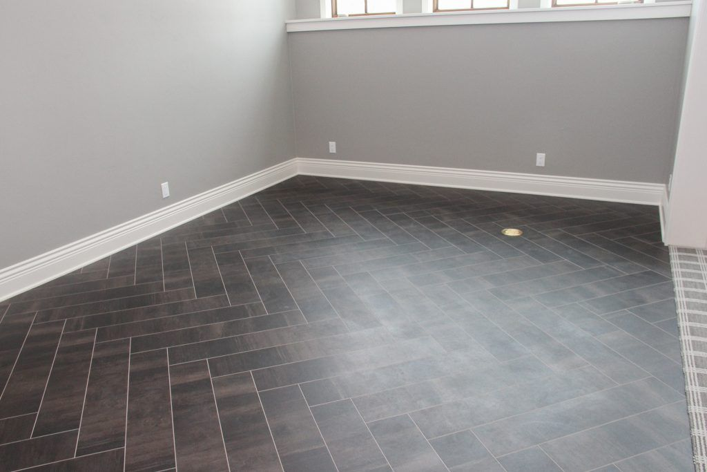 Dark Luxury Vinyl Tile Floor in Herringbone Pattern