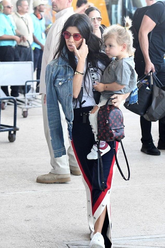 18a4b6b1eb78 Kourtney Kardashian wearing Mickey Mouse Camera Strap, Louis Vuitton Palm  Spring Mini Backpack, Gucci Wool Silk Jogging Pants, J Brand Deena Jacket  in ...
