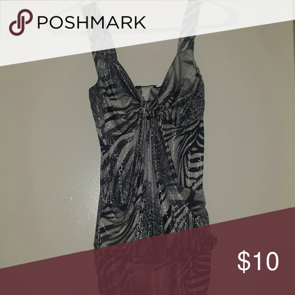 Snake print tank top Shiny silver, while and black snake print tank top. Pair ot with some leggings for very sexy outfit. Wet Seal Tops Tank Tops
