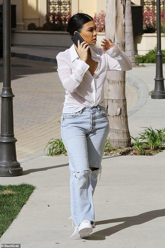 Kourtney Kardashian nails daytime chic in sheer white blouse and jeans