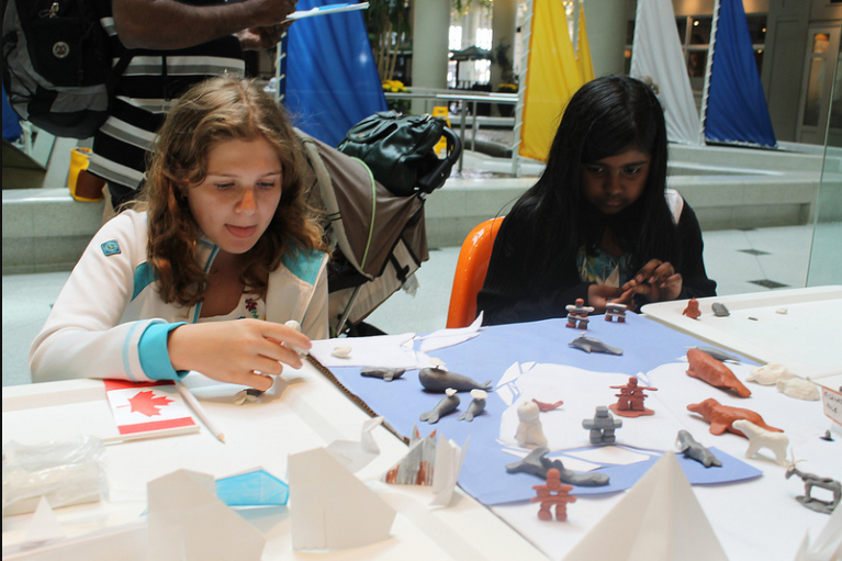 MIA visitors making animals and inuksuit as part of the Doors Open Toronto 2012 project: Arctic Landscape.