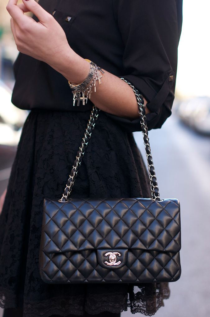 I Love This Quilted Black Chanel Bag With Subtle Silver Details The Short Chain Handle Is An Extra Nice Touch