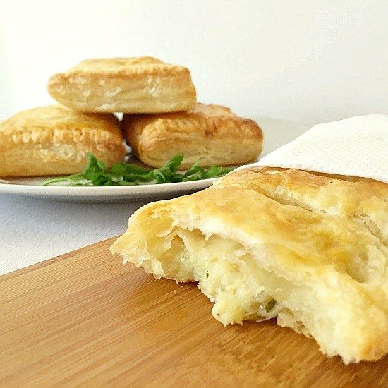 A halved potato cheese onion pasty with a white plate with 3 pasties in the background & Potato cheese onion pasty recipe | Appetizers | Pinterest | Onions ...