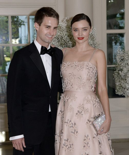 Miranda Kerr and her Snapchat CEO boyfriend, Evan Spiegel arrive at the state dinner in honor of President of Finland and the Prime Ministers of Norway, Sweden, Denmark and Iceland at the White House in Washington on May 13, 2016. / AFP / Olivier Douliery