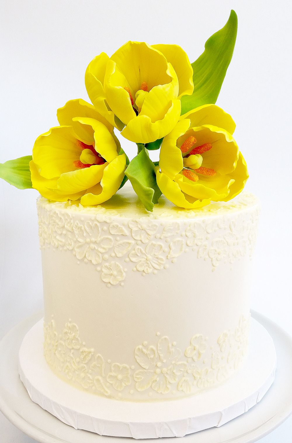 Petite wedding cake with hand piped lace and gum paste yellow tulips ...