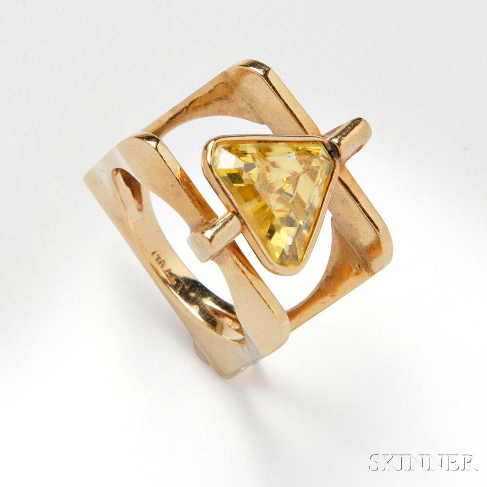 14kt Gold Ring, the fancy-cut yellow stone within a swiveling bezel