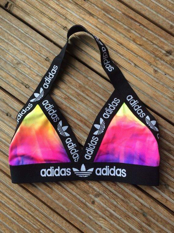 My latest handmade reworked Adidas halter neck bralette triangle bra.  Would also look great with a mesh/sheer crop top and shorts/jeans.  It is beautifully structured and lined .  Colours may vary from yellows to pinks to greens and blues. If you have a preference to specific main colour, please leave me a note in the order.  PLEASE PHYSICALLY MEASURE YOUR UNDERBUST TO GET YOUR BAND SIZE.  XS - Under Bust Band size 27.5 AA - A/B Cup S - Under Bust Band Size 28.5 B/C Cup M...