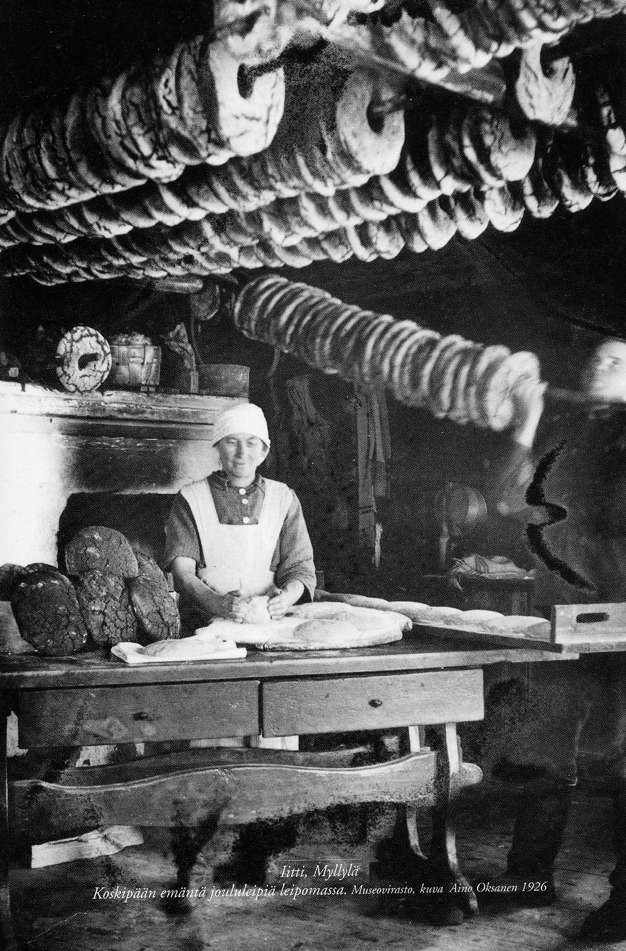 Woman making rye bread for Christmas in the village of Koskipää, northeast of Tampere, FInland.   Photography Aino Oksanen, 1926.