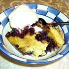 2 1/2 cups fresh or frozen blueberries  1 teaspoon vanilla extract              1/2 lemon, juiced  1 cup white sugar, or to taste  1/2 teaspoon all-purpose flour                                                      1 tablespoon butter, melted                                                      1 3/4 cups all-purpose flo