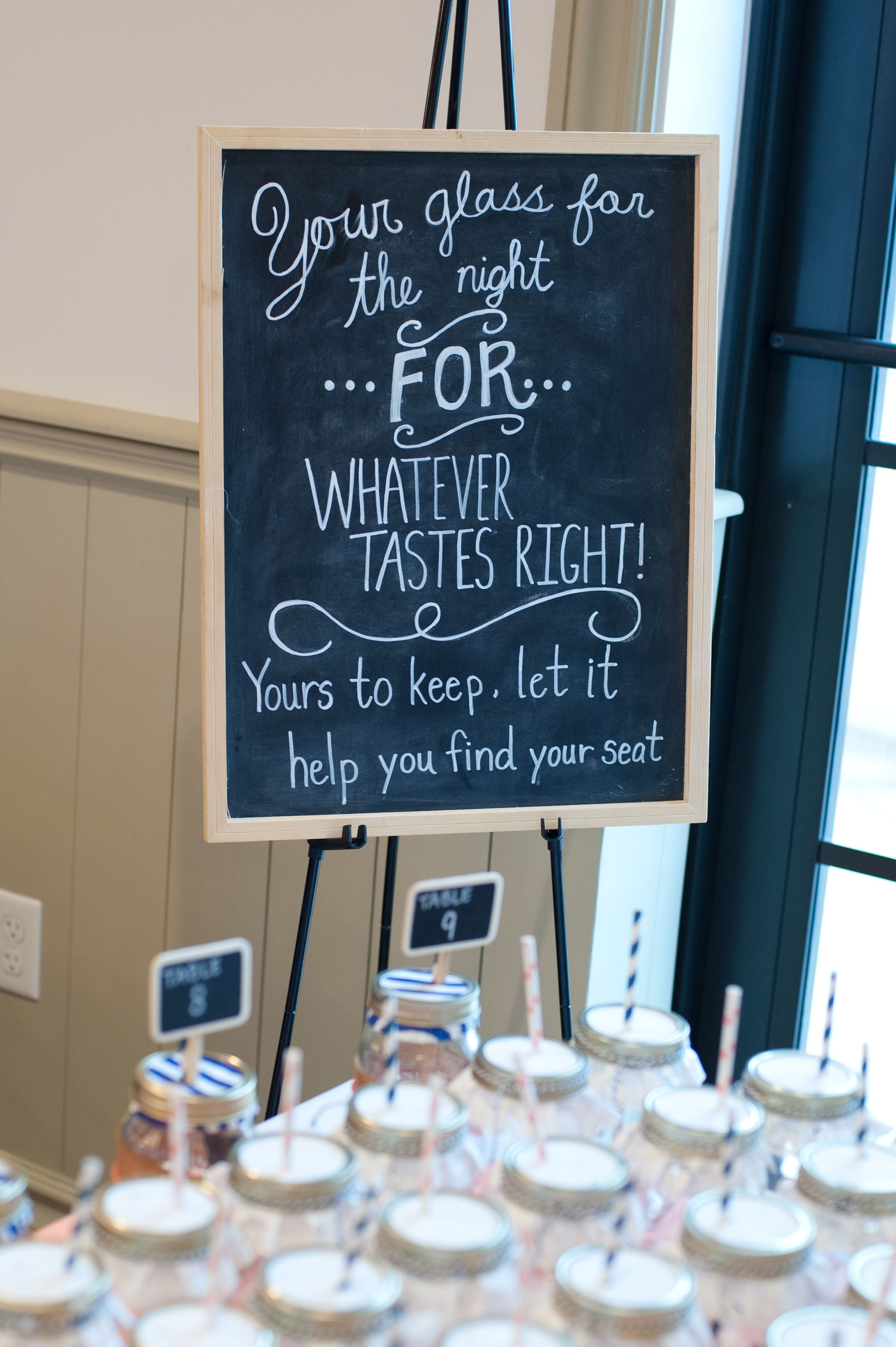 Chalkboard Sign In Front Of Mason Jars On Tables Your