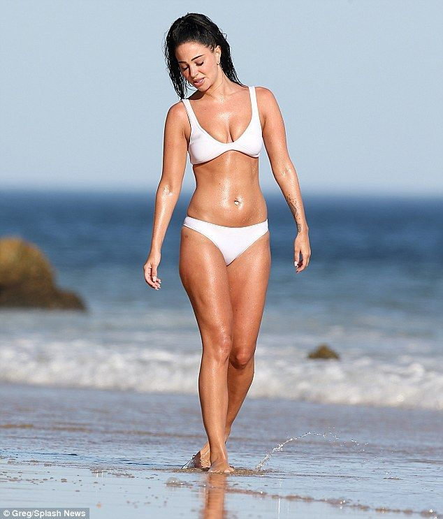 f3f5b5853c A bit of all-white  Tulisa looked magnificent as she strode along a beach  in Portugal while on a girly getaway recently