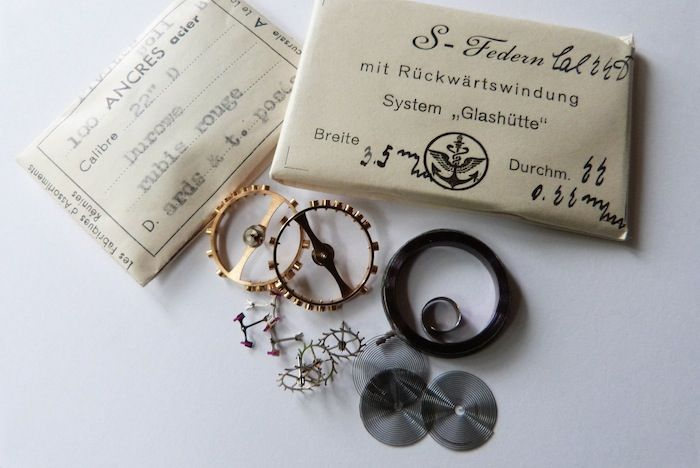 B-Uhr-parts1055mm B-Uhr Parts was also in the rubbish container ! This watchparts and watches were delivered to the Deutsche Luftwaffe. This parts are also original packed in 1944 !!!!!!  This set can now delivered as spare parts to the 55mm watch out of WW2