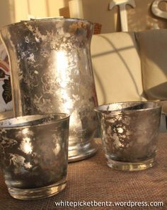 DIY Mercury Glass:  You'll need: Krylon Looking Glass Spray Paint; Glass vase, candle cup, etc.; Spray bottle with 1/2 water, 1/2 vinegar; Paper towels.
