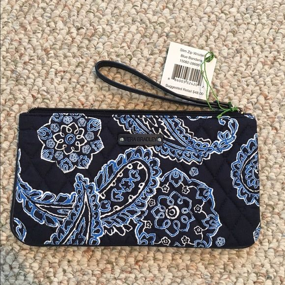 Slim Zip Wristlet Vera Bradley slim zip wristlet in her blue bandana fabric. Navy background with light blue and white. Inside fabric shown in photo #4 also has slots for credit cards and pocket. Vera Bradley Bags Clutches & Wristlets