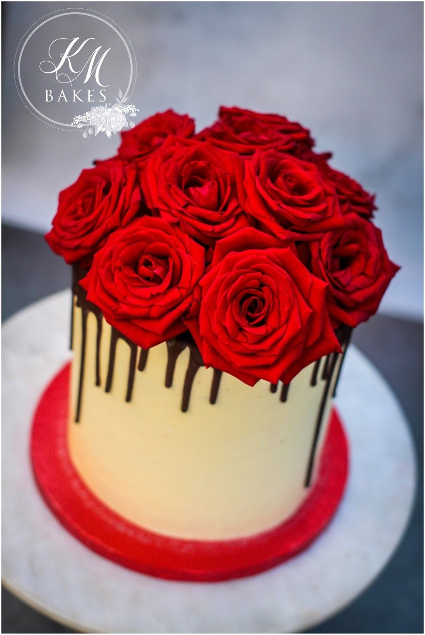 red roses cake on top of a dark chocolate drip