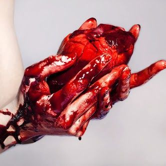 | the blood of the vile drips down each finger, the heart ...