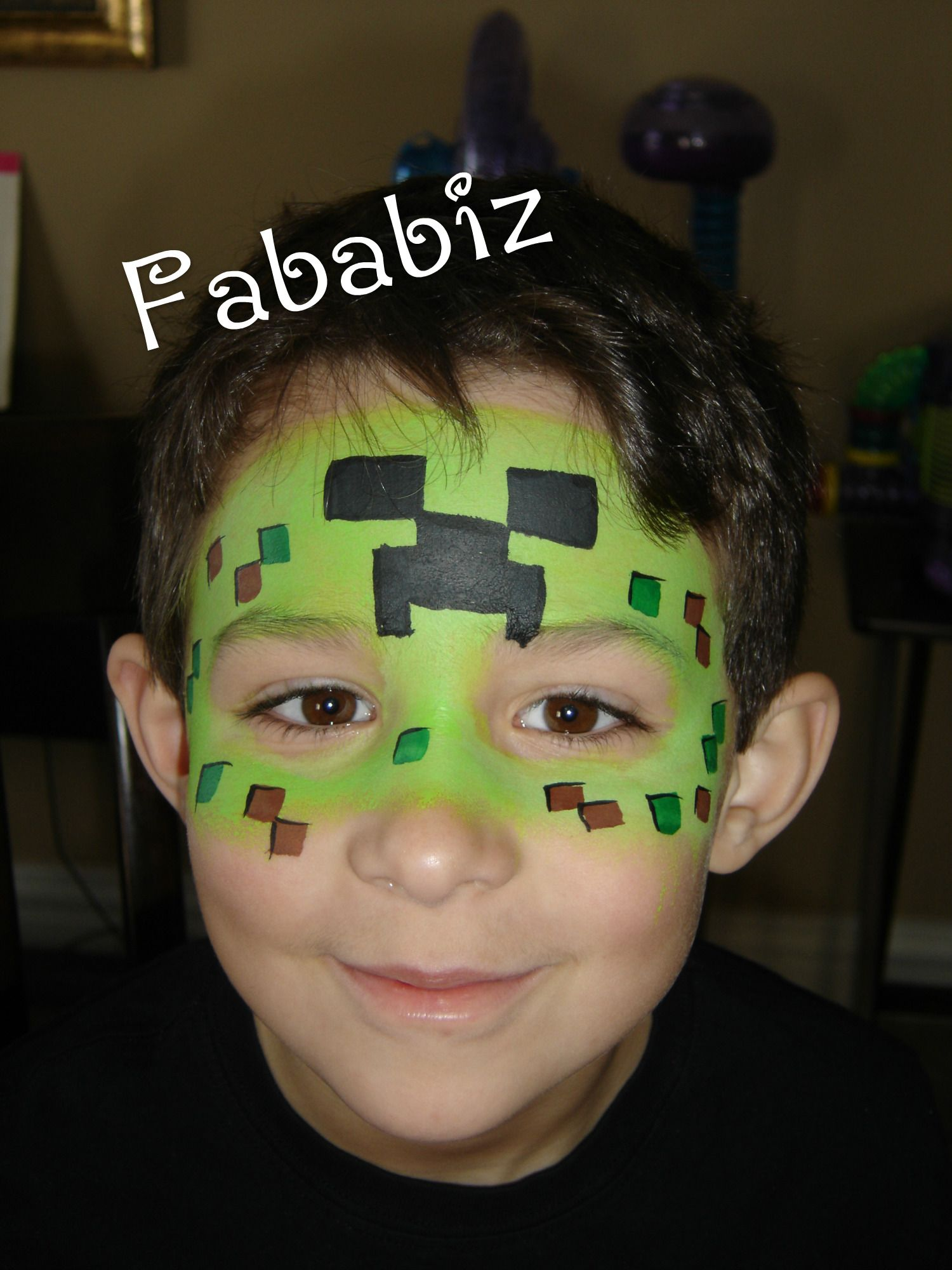 Boys favorite these days. A minecraft face painting. This is an