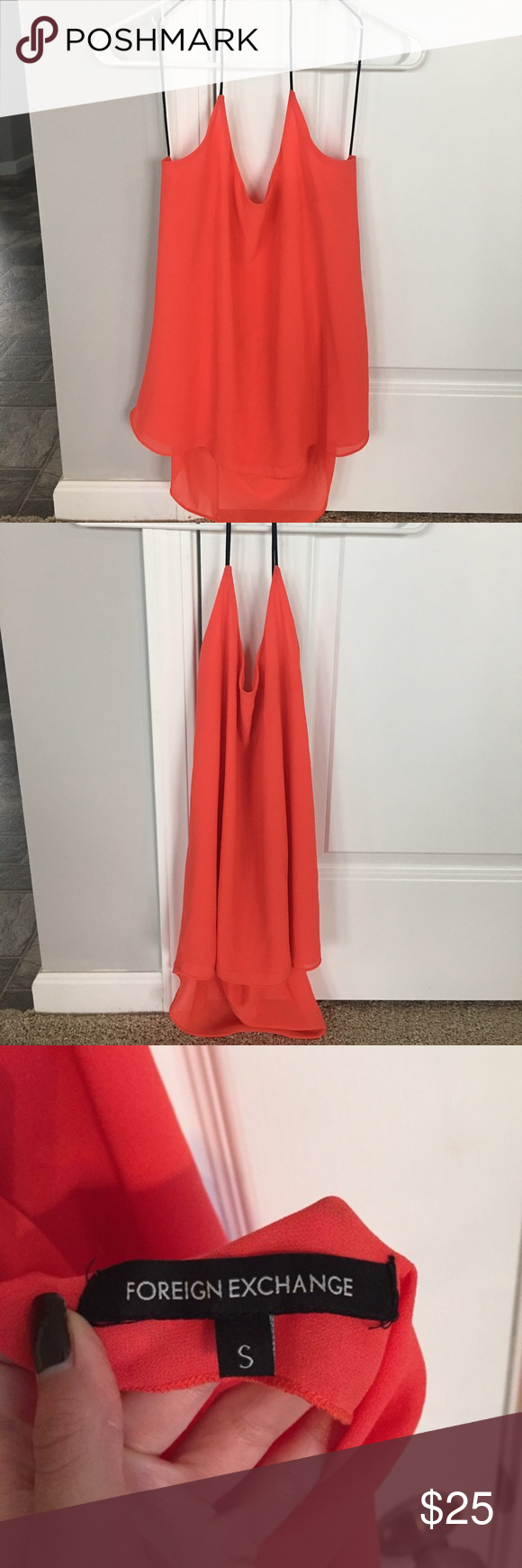 NWOT Sexy red Foreign Exchange top New without tag. Basically brand-new. Never worn. No flaws or imperfections. Very sexy red tank top with black skinny straps. A flowy piece. This would be great for date night! Foreign Exchange Tops Tank Tops