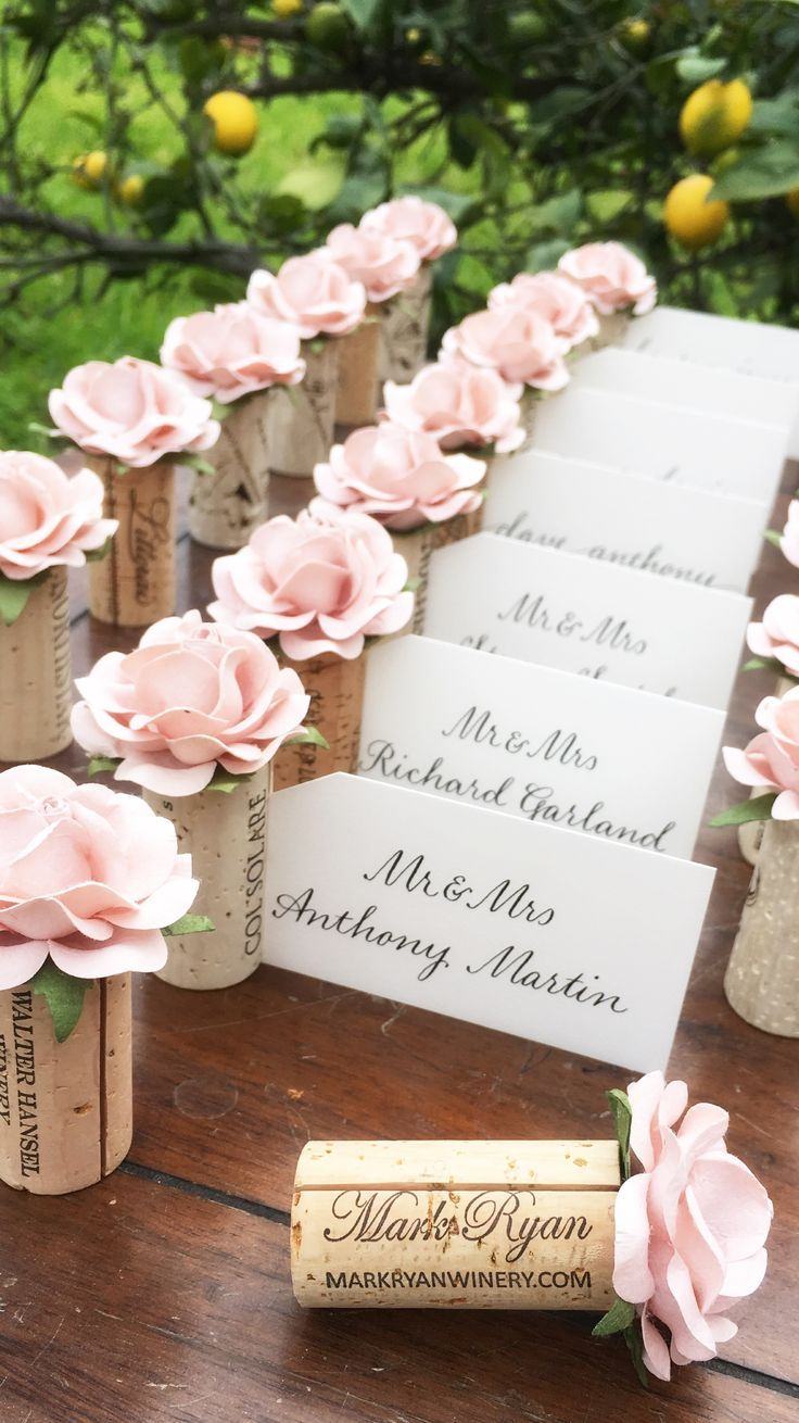 Wedding Place Card Holder is part of Wedding decorations - Welcome your reception guests with a lush, colorful garden of Place Card Holders!  FREE shipping on orders $25+  Blank name cards included! DETAILS  Impress your guests with unique Place Card presentation!  Personalize these beautiful name card holders for your special event with 20+ beautiful colors   Blank name cards (Soft Ivory color) are included with your order!  Send the cards out for professional calligraphy, or recruit your bridesmaids to show off their nicest handwriting  FAQ's How long will it take to receive my order  Most orders will ship within 12 weeks via USPS  If there will be a delay beyond 2 weeks, we will contact you right away  Ooooo, I need it sooner  Can you rush ship  Yes! Just select the  PRIORITY MAIL  option at check out for expedited processing and 23 day shipping via USPS Priority Mail  Can I mix colors  Yes! Simply add the colors & quantities separately to your cart, and proceed to check out  Any other questions  Be in touch by clicking the green  Contact Us  button on the side of your screen! OTHER INFO  Each vintage wine cork has a beautiful 2  handmade paper rose bloom  planted  on top   A vertical slit in the cork will hold your name cards upright   Finished Place Card Holder measures about 2 25  tall  THANK YOU to the following photographers for the beautiful images featured  Photo 4 kdortz  Photo 5 Aneliia Miller Photography  Photo 6 Brittany Lee Photography