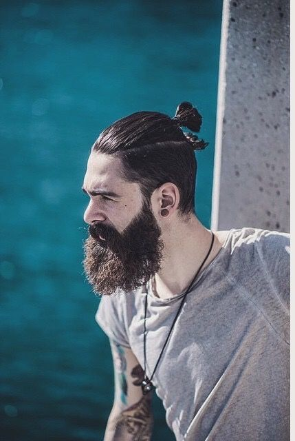 History of the Man Bun Undercut with Hipster beard style