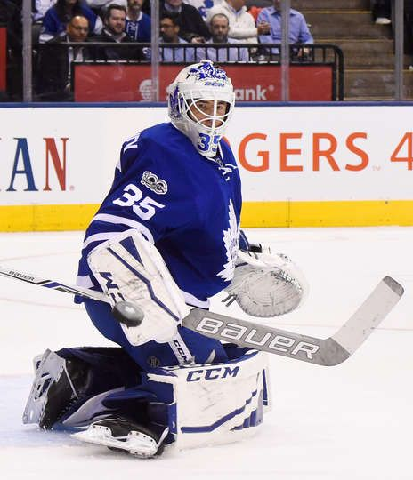 TORONTO, ON - MARCH 23: Curtis McElhinney #35 of the Toronto Maple Leafs makes a save against the New Jersey Devils during the first period at the Air Canada Centre on March 23, 2017 in Toronto, Ontario, Canada. (Photo by Graig Abel/NHLI via Getty Images)