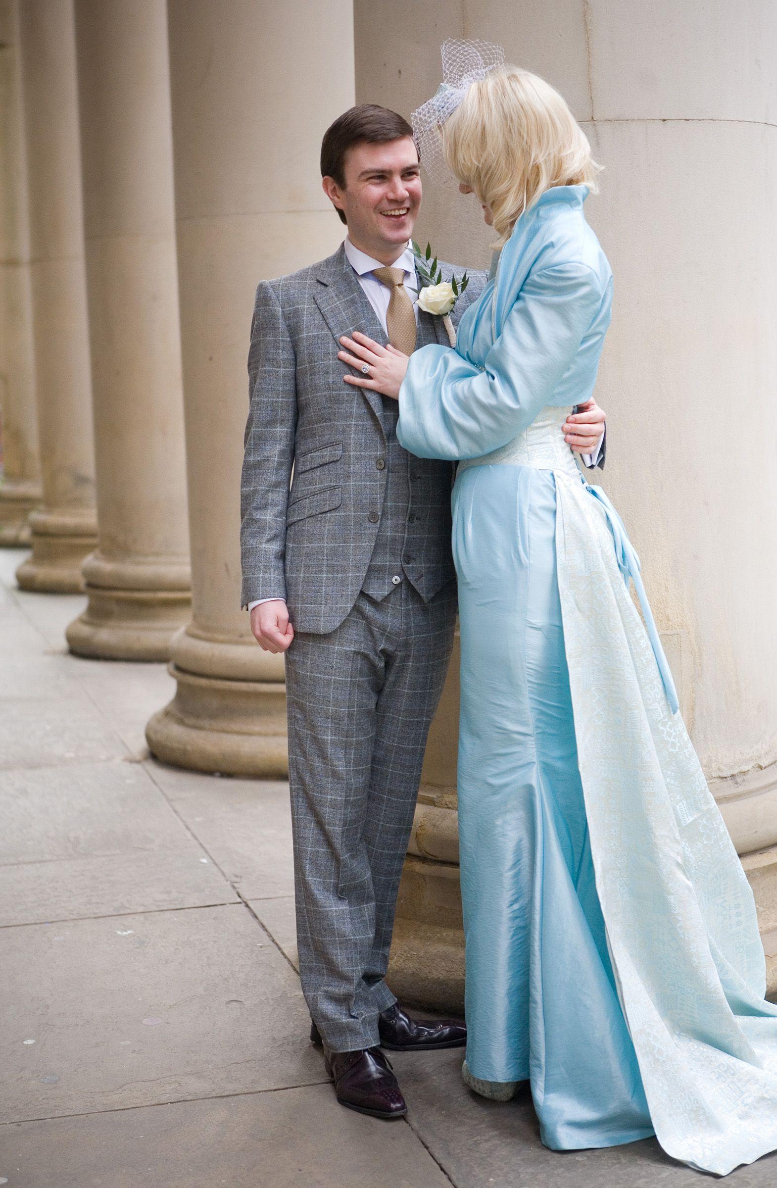 Bride and Groom pose together pastel wedding pastel blue wedding ...