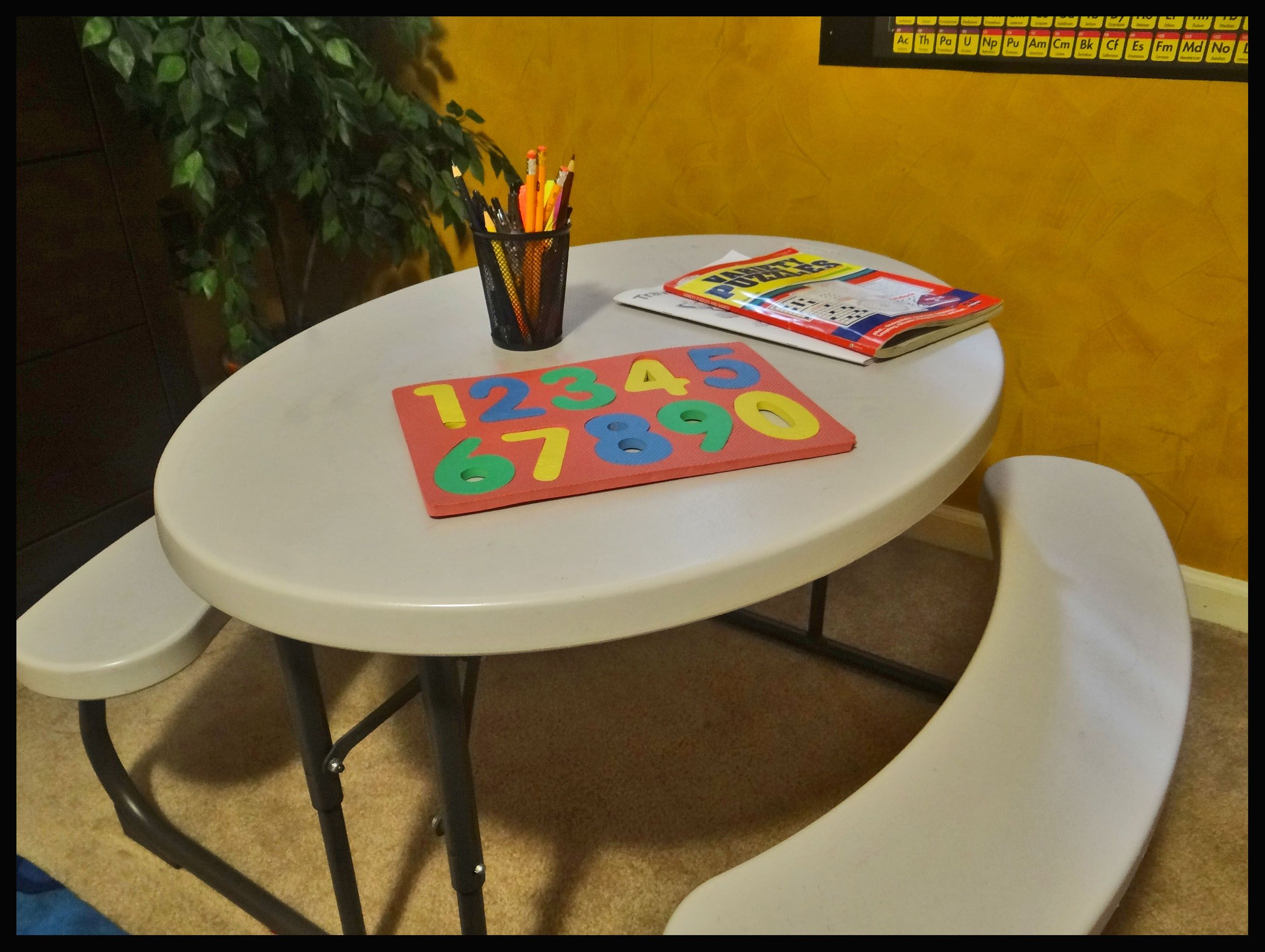 Work-table, picnic style! In addition to individual desks. The kids love this work area!