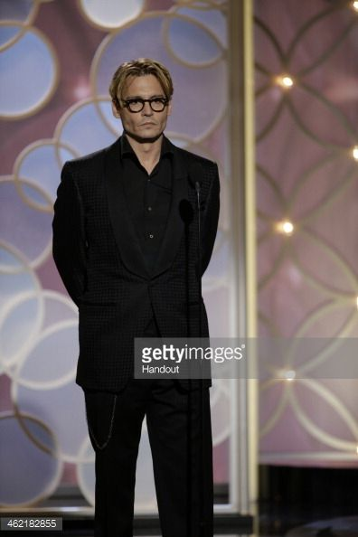 In this handout photo provided by NBCUniversal, Presenter Johnny Depp speaks onstage during the 71st Annual Golden Globe Award at The Beverly Hilton Hotel on January 12, 2014 in Beverly Hills,