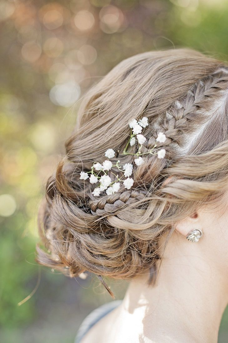 Gorgeous Braided Updo and tug a sprig of Baby's Breath in hair #weddinghair #weddinghairstyle #hairstyle