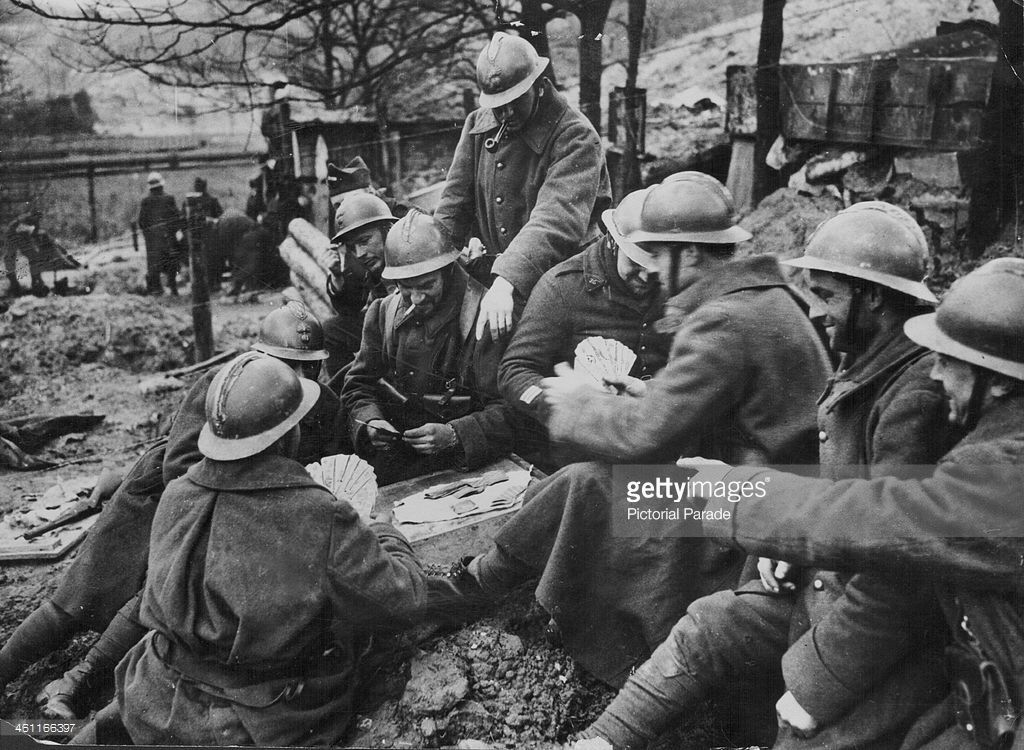 French soldiers playing cards to pass the time, on the Maginot Line during World War Two, circa 1939-1945.