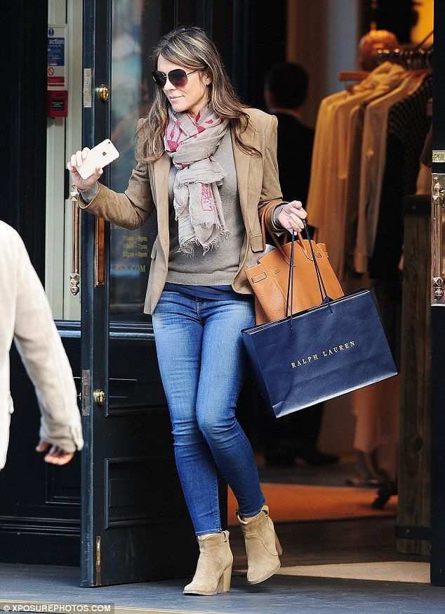 Keeping it casual: Elizabeth Hurley was seen shopping on Fulham Road on Tuesday afternoon, flying solo