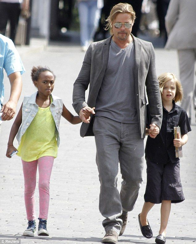 Brad Pitt strolls through Moscow, Russia with daughters Zahara and Shiloh  on Thursday