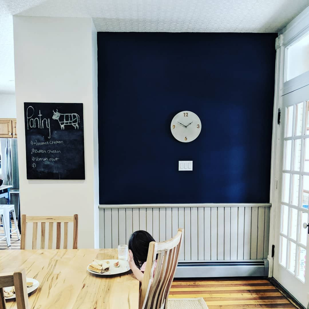 Navy Blue Accent Wall In Farmhouse Kitchen With Concrete Clock