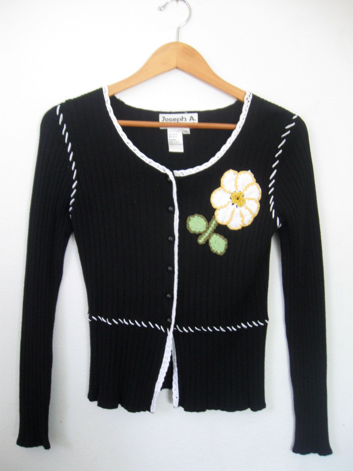 A personal favorite from my Etsy shop https://www.etsy.com/listing/225656172/black-white-fitted-sweater-with