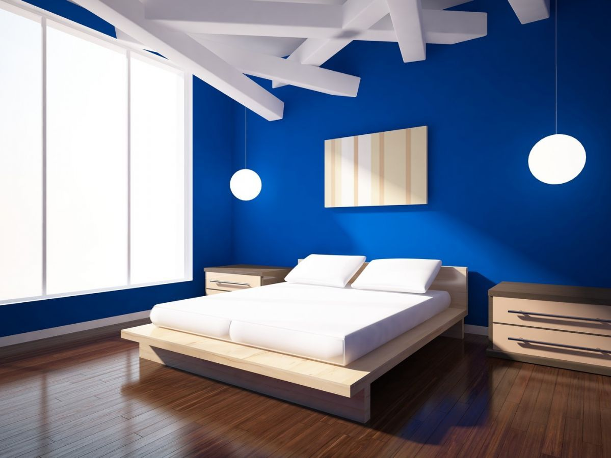 Bright Blue Walls Bring This Modern Bedroom To Life Blue Bedroom Walls Royal Blue Bedrooms Blue Walls Living Room