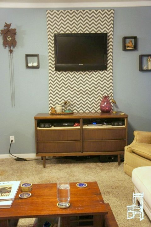 hide TV cables with a fabric panel behind a wall-mounted TV ...