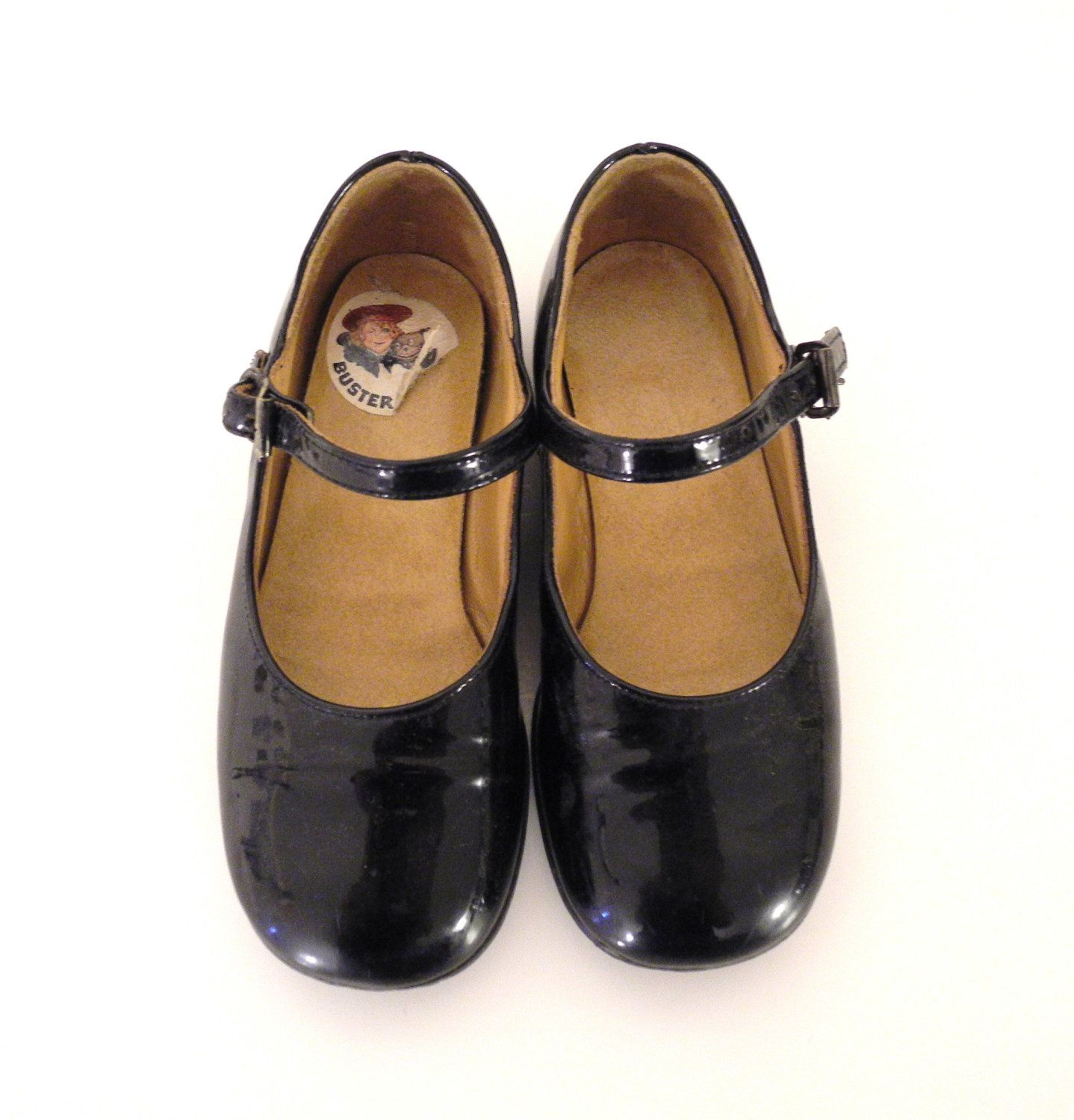 Black patent leather Mary Jane shoes by Buster Brown from the 1960s