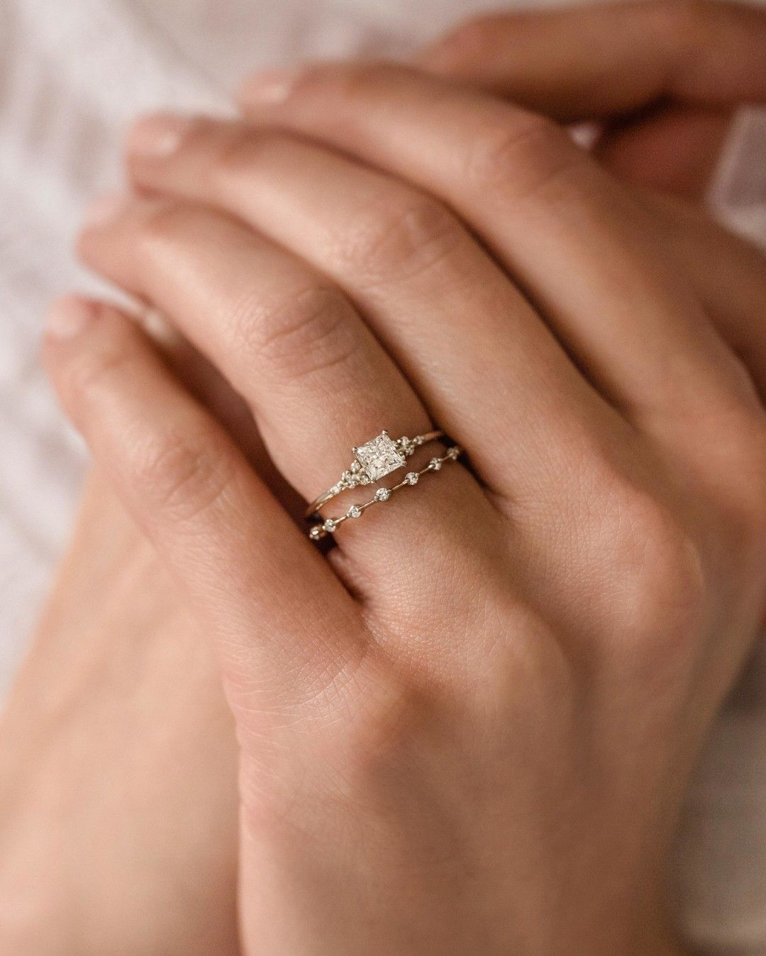 A dainty white gold engagement ring- the Lighthouse Ring with a 0.5ct. princess