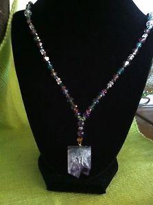 Multi-colored Swarovski crystal beads with Beautiful Amethyst & Green Pendant.
