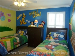 Disney Room at this 6 bedroom, 4 bathroom villa in Kissimmee, FL. This kids room has 2 twin beds and is decorated in classic Mickey Disney style.